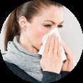 Niesanfälle und Schnupfen